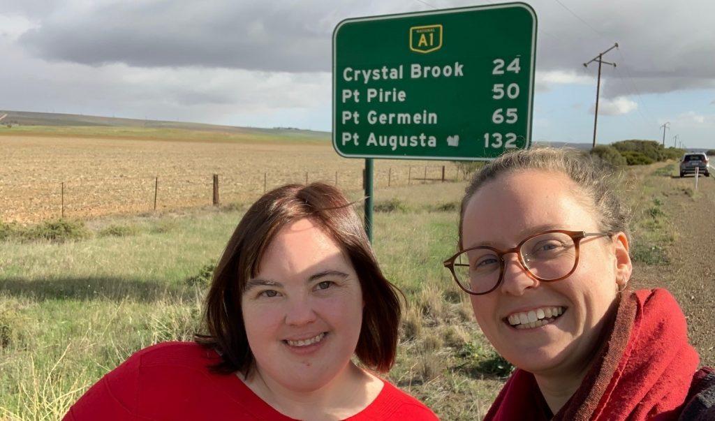 Jill and Sarah at rural town sign